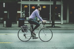 A happy person riding a bike showing the benefits of mindfulness in the workplace for well-being quality of life